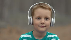 Happy Little Boy With Headphones,Outdoor stock video