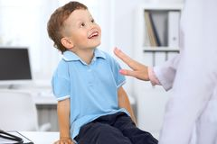 Happy little boy after health exam at doctor`s office.  royalty free stock photos