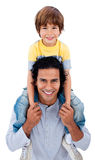 Happy little boy on his father's shoulders. Against a white background Royalty Free Stock Images