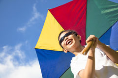 Happy little boy hold a colorful umbrella Stock Photos