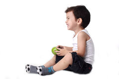 Happy Little boy holding apple Stock Photo