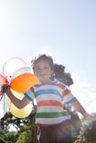 Happy little boy holding balloons Stock Image
