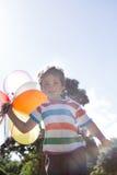 Happy little boy holding balloons Stock Image