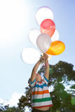Happy little boy holding balloons Stock Photography