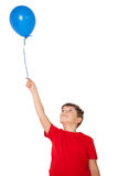 Happy little boy holding blue balloon Royalty Free Stock Image