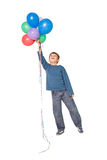 Happy little boy holding bunch of balloons Stock Photo
