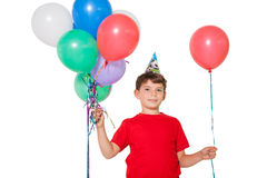 Happy little boy holding bunch of balloons Stock Photos