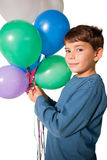 Happy little boy holding bunch of balloons Stock Images