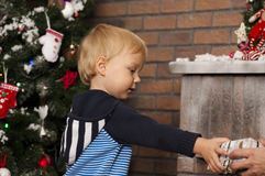 Happy little boy holding gift box Stock Photo