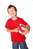Happy little boy holding gift. Stock Photos