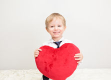 Happy little boy holding heart Royalty Free Stock Image
