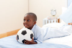 Happy little boy holding a soccer ball Stock Photography