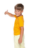 Happy little boy holds his thumb up Royalty Free Stock Images