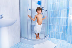 Happy little boy in the hotel shower Royalty Free Stock Image