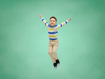 Happy little boy jumping in air over school board Royalty Free Stock Photography