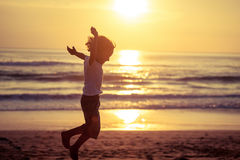 Happy little boy jumping on the beach Royalty Free Stock Image