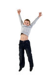 Happy Little Boy Jumping In Mid. Stock Image