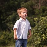 Happy little boy is jumping outdoor. Royalty Free Stock Photo