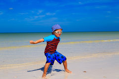 Happy little boy jumping on sand beach Royalty Free Stock Photo