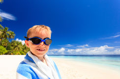 Happy little boy laugh wrapped in beach towel Royalty Free Stock Photos