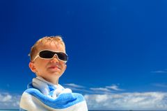 Happy little boy laugh wrapped in beach towel Royalty Free Stock Photo