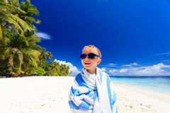 Happy little boy laugh wrapped in beach towel Stock Image