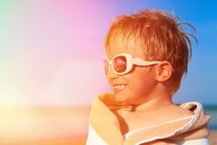 Happy little boy laugh wrapped in beach towel on Royalty Free Stock Photography