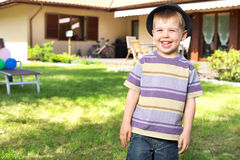 Happy little boy laughing to the camera Stock Photos