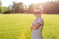 Happy little boy laying on the grass Stock Photo