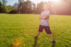 Happy little boy laying on the grass Stock Photos