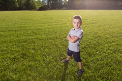 Happy little boy laying on the grass Stock Images