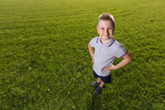 Happy little boy laying on the grass Royalty Free Stock Images