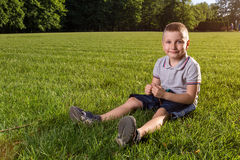 Happy little boy laying on the grass Royalty Free Stock Photo