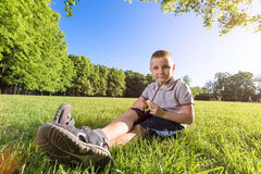 Happy little boy laying on the grass Stock Photography