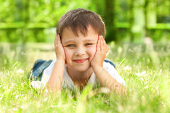 Free Happy Little Boy Laying On The Grass Royalty Free Stock Photo - 14803265