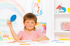 Happy little boy learning shapes in kindergarten Stock Photos
