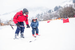 Happy little boy learning skiing with his father in Kitzbuhel ski resort, Tyrol, Austria Stock Photography