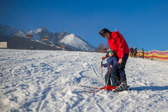 Happy little boy learning skiing with his father in Slovakia Stock Photos