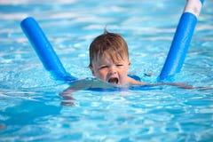 Happy little boy learning to swim Stock Photo