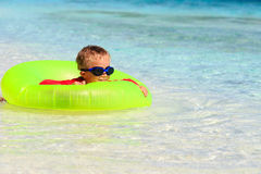 Happy little boy with life ring has fun on beach Royalty Free Stock Photos