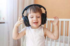 Happy little boy listening to music with headphones Royalty Free Stock Photo
