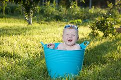 Happy little boy looking out from swimming pool Stock Images