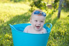Happy little boy looking out from swimming pool Royalty Free Stock Photos