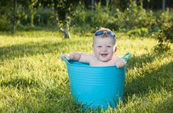 Happy little boy looking out from swimming pool Royalty Free Stock Images