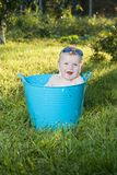 Happy little boy looking out from swimming pool Royalty Free Stock Photo