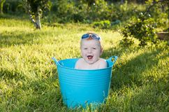 Happy little boy looking out from swimming pool Stock Photo