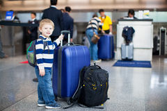 Happy little boy with luggage stock photography