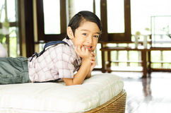 Happy little boy lying in bed Royalty Free Stock Images