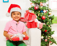 Happy little boy with many xmas presents Stock Photo