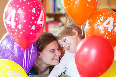 Happy little boy and mother celebrating his 4 birthday with colo Royalty Free Stock Image